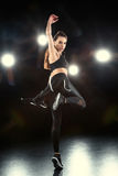 Woman dancing in sportive clothing Royalty Free Stock Photo