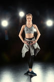 Woman dancing in sportive clothing Stock Photography