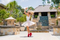 Woman dancing on the street in high heels Royalty Free Stock Image