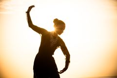 Woman dancing at sunrise Stock Image