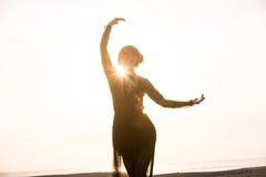 Woman dancing at sunrise Stock Photos