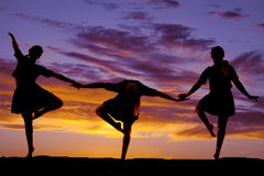 Woman dancing in the sunset three poses Stock Image