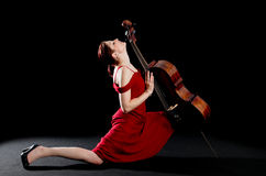 Woman dancing the tango with a cello Stock Photos