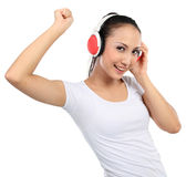 Woman dancing to music with headphones Royalty Free Stock Image