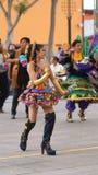Woman dancing traditional dance of Bolivia in the Ciudad Mitad del Mundo turistic center near of the city of Quito Stock Photo