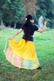 Woman dancing with traditional fan Royalty Free Stock Images