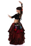 Woman dancing trible eastern belly dance. Back side. Royalty Free Stock Photography