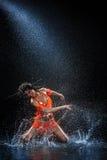 Woman dancing under rain Royalty Free Stock Photos