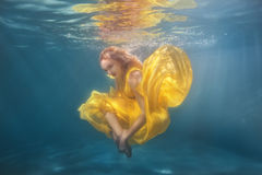 Woman dancing underwater. Stock Images