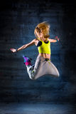 Woman dancing in urban environment Royalty Free Stock Image