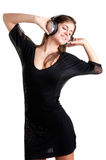 Woman Dancing. Using headphones isolated in a white background Stock Image