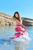 Woman dancing in water Royalty Free Stock Photos
