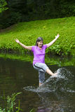 Woman dancing in water Royalty Free Stock Photo