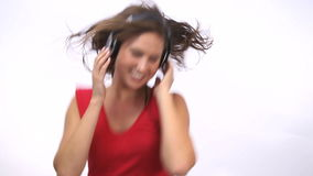 Woman dancing while wearing headphone stock video