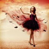 Woman dancing. Young woman dancing for her abstract background royalty free stock photography