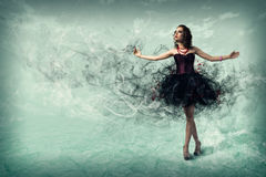 Woman dancing. Young woman dancing for her abstract background royalty free stock images
