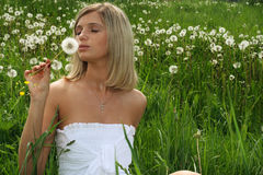 Woman with dandelion Royalty Free Stock Images