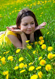 Woman in dandelion Stock Photo