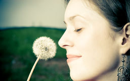 Woman with dandelion Stock Images