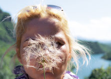 Woman with dandelion Stock Photography