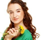 Woman with dandelion bouquet Stock Images