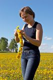 Woman with Dandelion chain Stock Images