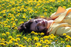 Woman in Dandelion Field Stock Images