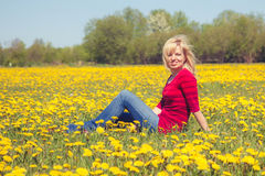 Woman in dandelion field Royalty Free Stock Photo