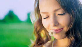 Woman with a dandelion Stock Photo