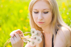 Woman with dandelions Royalty Free Stock Images