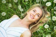 Woman among dandelions Stock Photography