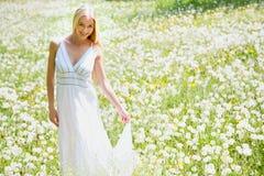 Woman among dandelions Royalty Free Stock Photo