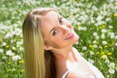 Woman among dandelions Stock Photo