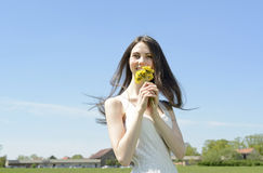 Woman with dandelions Royalty Free Stock Image