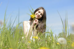 Woman with dandelions Stock Photography
