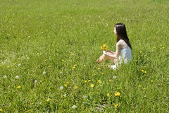 Woman with dandelions Royalty Free Stock Photo