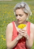 Woman with dandelions Stock Image
