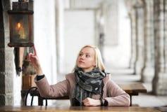 Woman dangerously touching the lantern Stock Photography