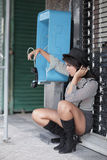Woman dangling the phone Royalty Free Stock Image