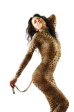 Woman in dappled catsuit. Woman is bending as a cut. She is wearing leopard catsuit stock photo