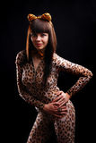 Woman in dappled catsuit Royalty Free Stock Photography