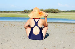 Woman in dark blue bikini Stock Photo