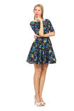 Woman in dark blue floral dress isolated on white Royalty Free Stock Image