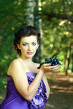Woman dark blue grapes Royalty Free Stock Image