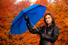 Woman with a dark blue umbrella Stock Image