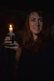 Woman in the dark with a candle Royalty Free Stock Image
