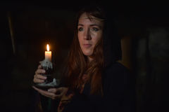 Woman in the dark with a candle Royalty Free Stock Photography