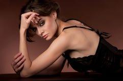 Woman in a dark dress Stock Photo