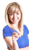 Woman with dark eyes and blue shirt pointing at camera Stock Photography