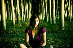 Woman in dark forest Royalty Free Stock Photo